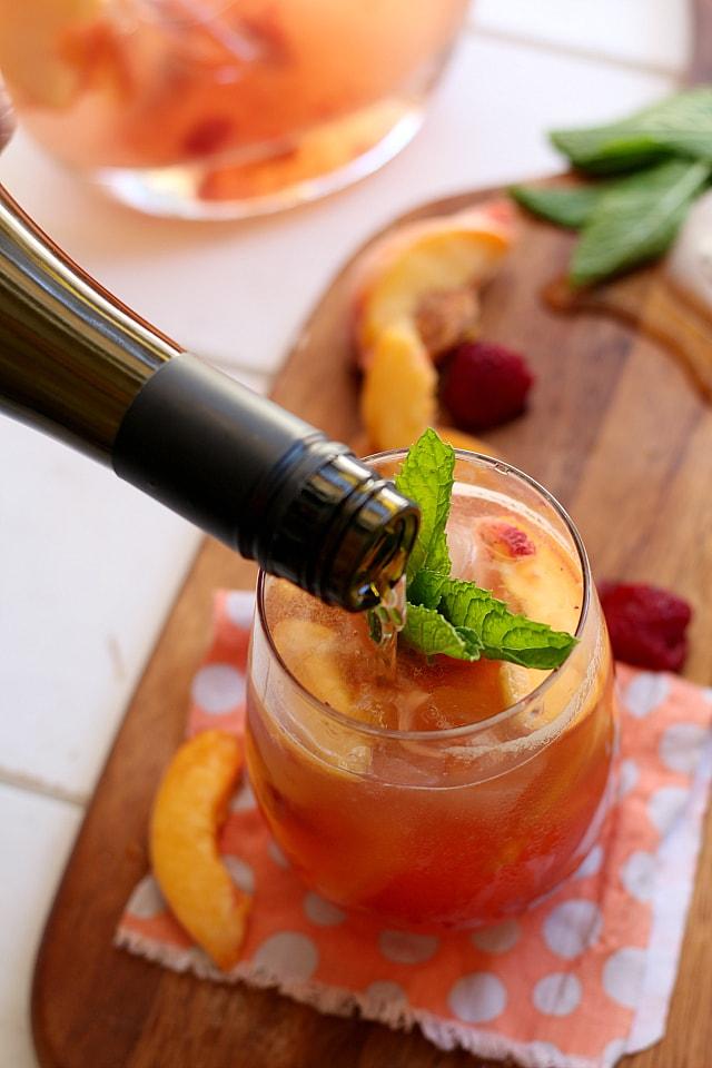 pouring sparkeling white peach sangria