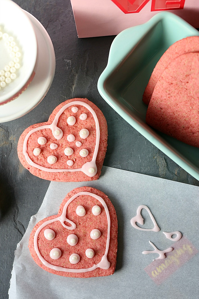 Soft vegan healthy sugar cookies made with coconut oil are beautifully colored pink naturally from beets! A gluten free cookie you can feel good about eating and pretty enough for Valentine's Day! | #healthy #vegan #sugar #cookie #easy #quick #beets #recipe | delightfulmomfood.com
