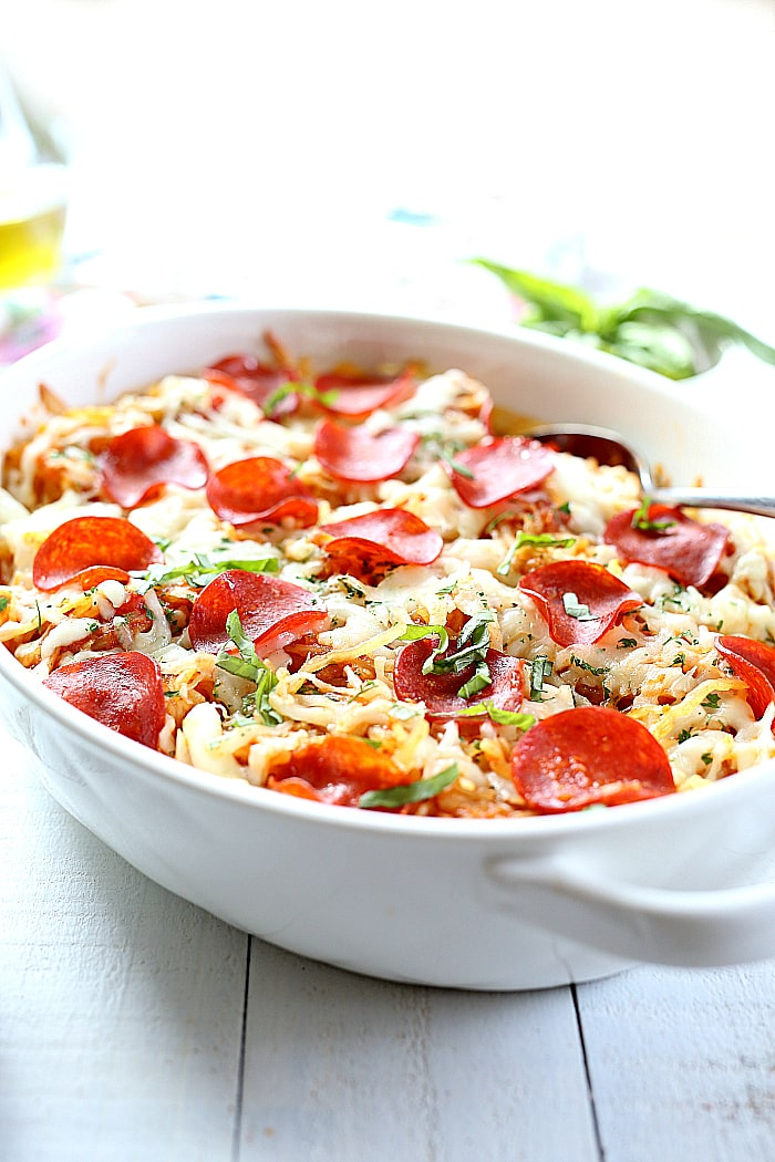 4-Ingredient baked spaghetti squashpizza casserole topped with turkey pepperoni is almost the easiest low-carb & one-dish dinner you will love! Roast a spaghetti squash ahead of time for a delicious quick dinner in 30 minutes or less!