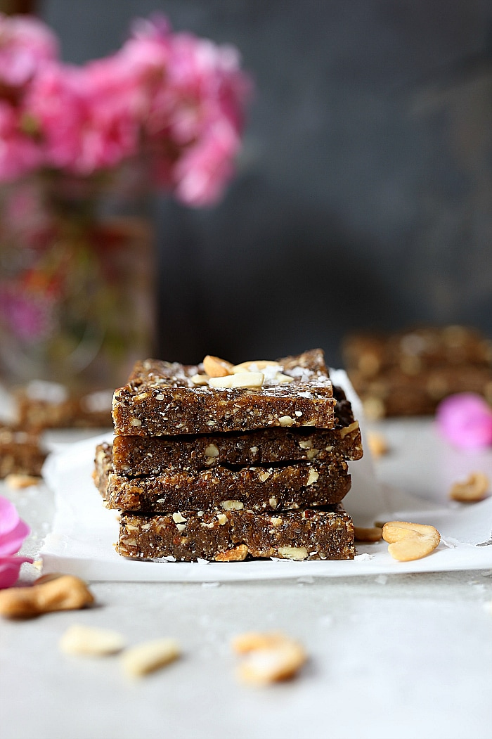 Heavenly date bars that are devilishly good! A decadent raw bar rich in natural sweetness from Medjool dates! These easy raw chia date bars take as little as 10 minutes to make! They are the deliciously soft and make the perfect superfood energy pick-me-up after a workout or first thing in the morning! #raw #date #bars #snacks #healthy #glutenfree #grainfree #paleo #easy #homemade | Recipe at delightfulmomfood.com