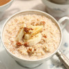 Creamy Instant Oatmeal Topped with Bananas and Pecans