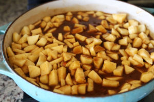 apple pie filling in a jar with a spoon