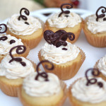 White Cupcakes With Coconut Buttercream Frosting