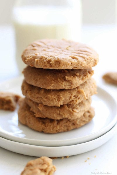 gluten free almond butter cookies stacked on a white plate