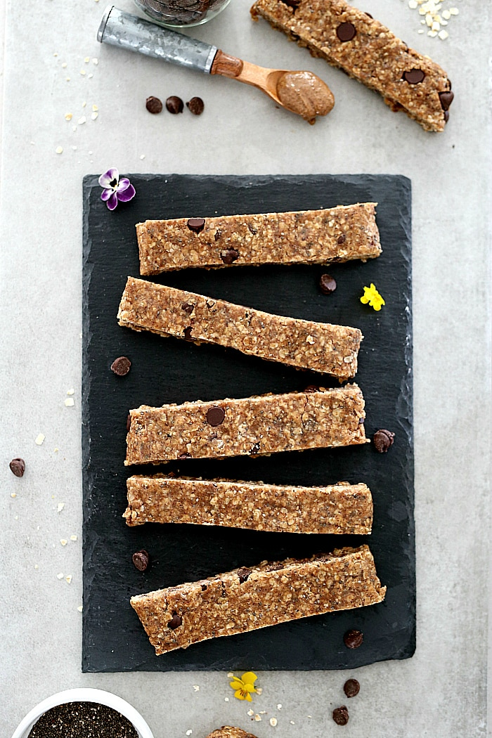 No-bake breakfast bars make the perfect on-the-go balanced meal for kids and adults! These incredibly easy homemade granola bars take little time to make and are made with wholesome oats, almond butter and no refined sugars. An addictive gluten free treat you will want to nibble on to energize all day long! #nobake #breakfast #bars #oats #easy #quick #healthy #glutenfree #breakfast #snack #wholesome #recipe | Recipe at delightfulmomfood.com