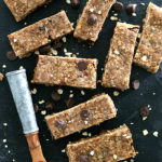 No bake breakfast bars make the perfect on-the-go balanced meal for kids and adults! These incredibly easy homemade granola bars take little time to make and are made with wholesome oats, almond butter and no refined sugars. An addictive gluten free treat you will want to nibble on to energize all day long! #nobake #breakfast #bars #oats #easy #quick #healthy #glutenfree #breakfast #snack #wholesome #recipe | Recipe at delightfulmomfood.com