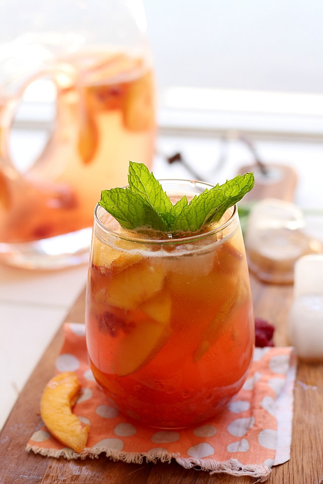 White peach sangria sweetened naturally with fresh berries, peaches ...