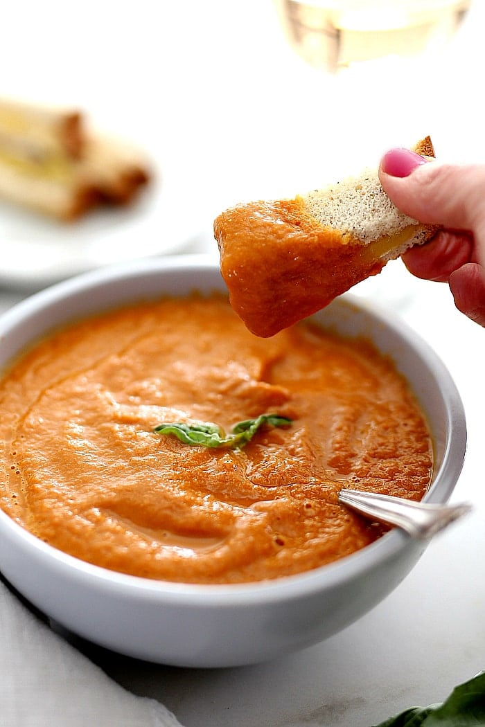 Tomato basil soup is a great way to use up fresh tomatoes and basil in an easy vegan soup!  Serve this gazpacho style or warm with gluten free grilled cheese or bread and the crowd will go wild! #tomato #basil #soup #recipe #fresh #tomatoes #glutenfree #vegan #Italian #easy #quick #gourmet | recipe at delightfulmomfood.com