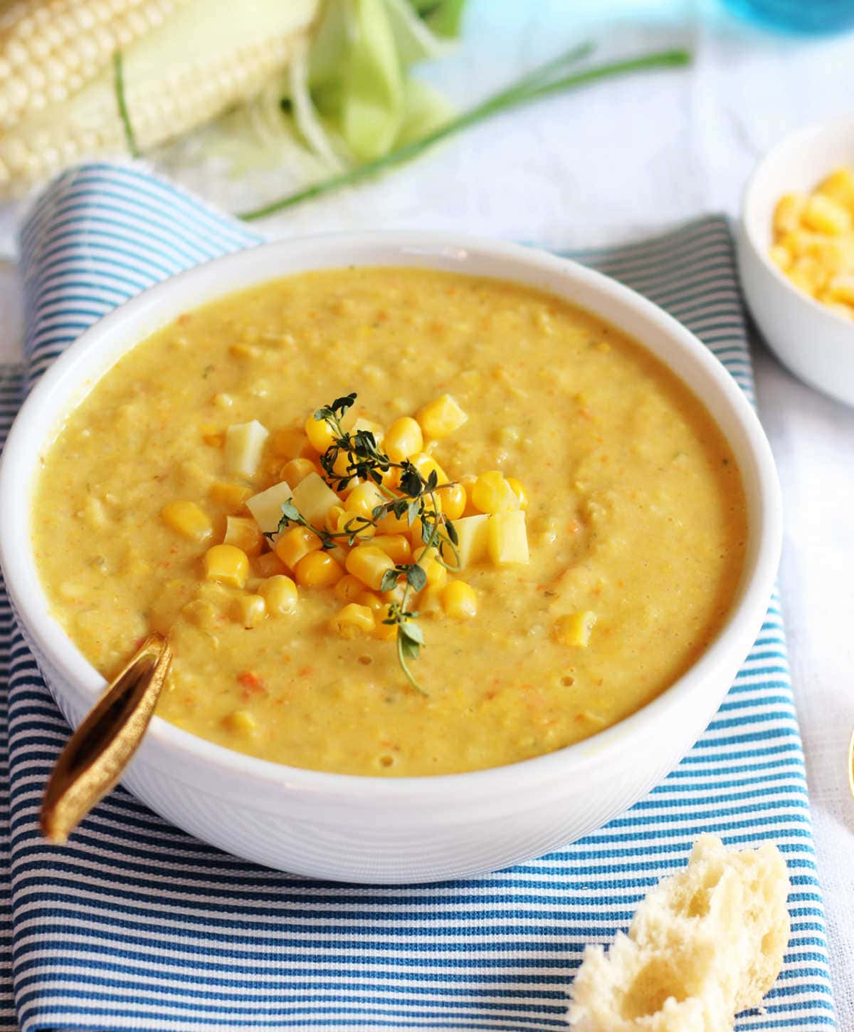 dairy free corn chowder in a bowl that is made with sweet corn, coconut cream, and potatoes