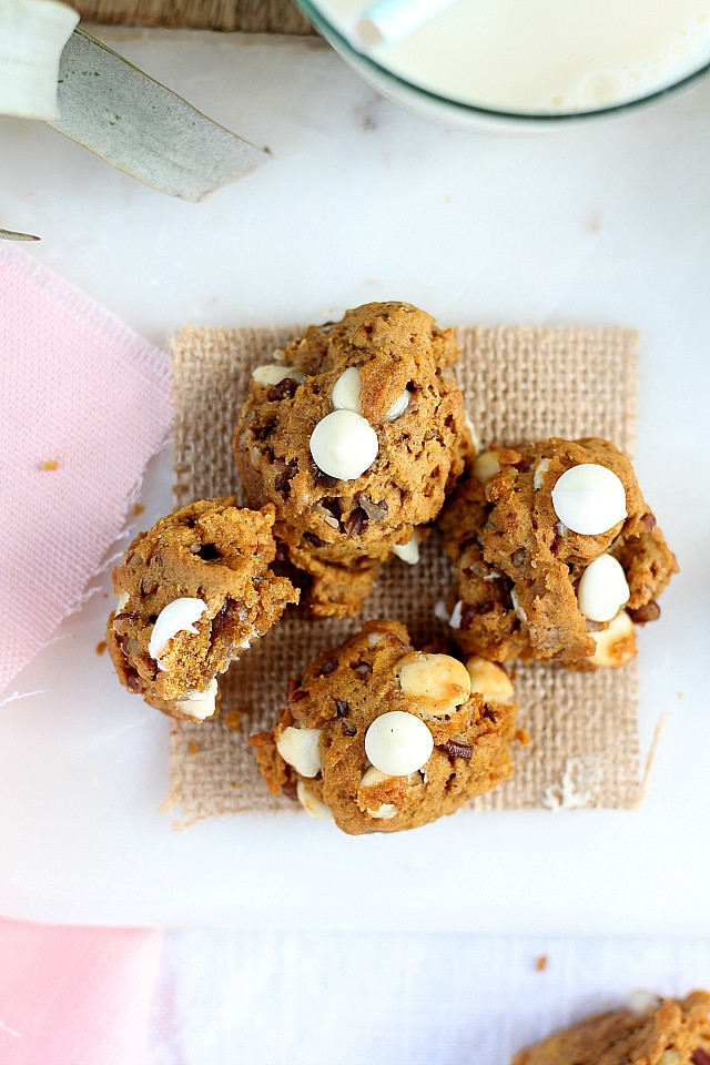 Pumpkin cookies baked perfectly round and chewy with white chocolaty creamy flavor!