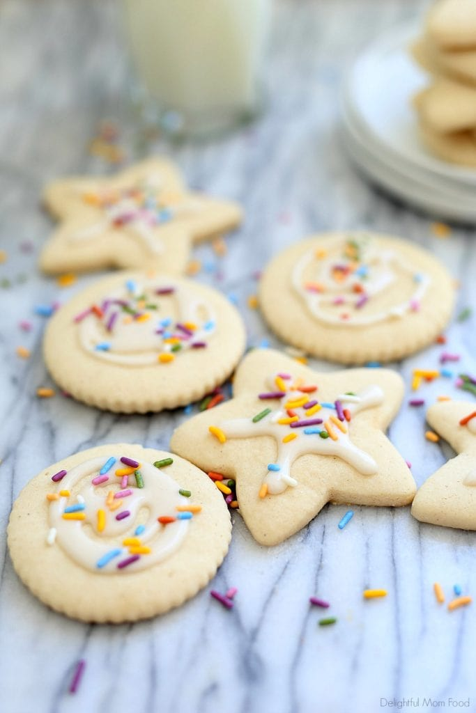 vegan gluten free sugar cookies cut out with icing and sprinkles