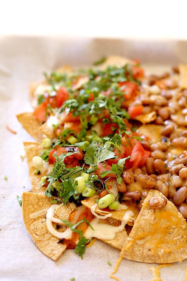 Healthy sheet pan nachos with vegetarian toppings