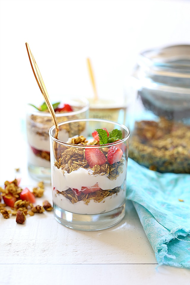 Crunchy turmeric granola parfait recipe that takes turmeric to a whole new delicious level! I love eating turmeric any way I can get it and this turmeric granola is one way my kids will eat it too!