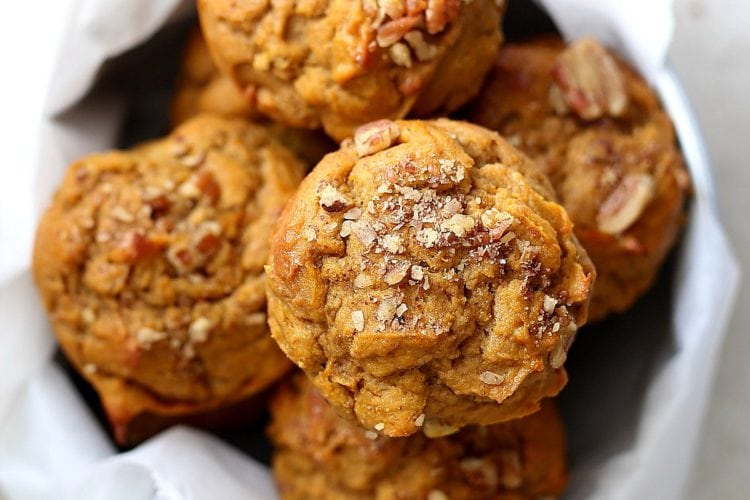 Gluten Free Pumpkin Muffins you will fall in love with and want to eat for days! Naturally dairy-free healthy muffins made with gluten free flours (with a grain free option), coconut sugar, pumpkin and comforting spices! #glutenfreepumpkinmuffins #pumpkinmuffins #baking #glutenfree #easymuffins #kidfriendly #pumpkin #dairyfreeglutenfree #dairyfree #snacks #breakfast #muffins | Recipe at Delightful Mom Food