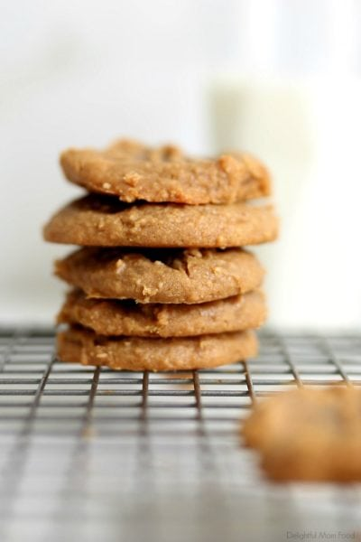 Chewy healthy peanut butter cookies that are secretly vegan and gluten free with a flourless option! So healthy with only 5 simple ingredients and made without butter yet packed with nutritious flavor! You'll even want to eat all the dough before it gets to the oven! #healthy #peanutbutter #cookies #vegan #glutenfree #dessert #treats #sweets #peanutbuttercookies #cookie #recipe | Recipe at Delightful Mom Food