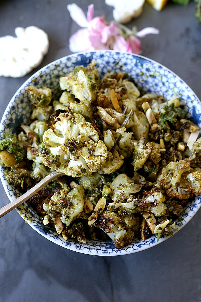 Roasted Cauliflowerwith Almond Pesto tossed together in a fragrant topping with crunchy toasted almond slivers will be your new favorite side dish! It is plant based, nourishing and made with vegan gluten-free ingredients. #healthy #paleo #vegan #keto #whole30 #recipe #cauliflower #roasted   delightfulmomfood.com