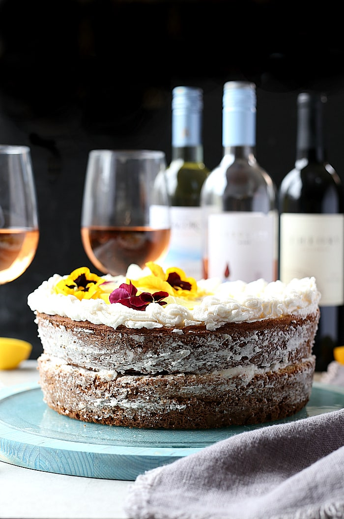 Lemon Yogurt Cake with natural refined sugar free coconut oil icing! An elegant citrus cake to bring to your next celebration. Pairs deliciously with a chilled glass of Rosé wine!