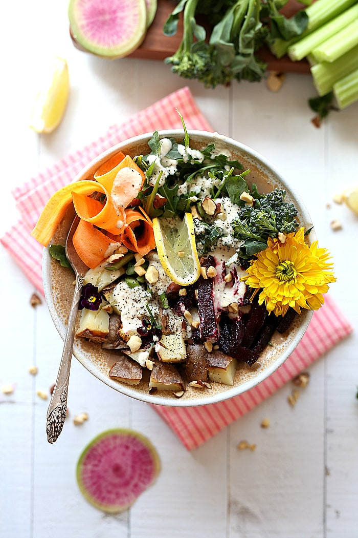 Everything but the kitchen sink in this spring root vegetable salad! It's a flavorful vegan and gluten-free kitchen sink salad made with leftover vegetables that would otherwise get thrown away! #spring #summer #salad #healthy #glutenfree #vegan #arugula #kitchensinksalad #recipe #maindish   delightfulmomfood.com