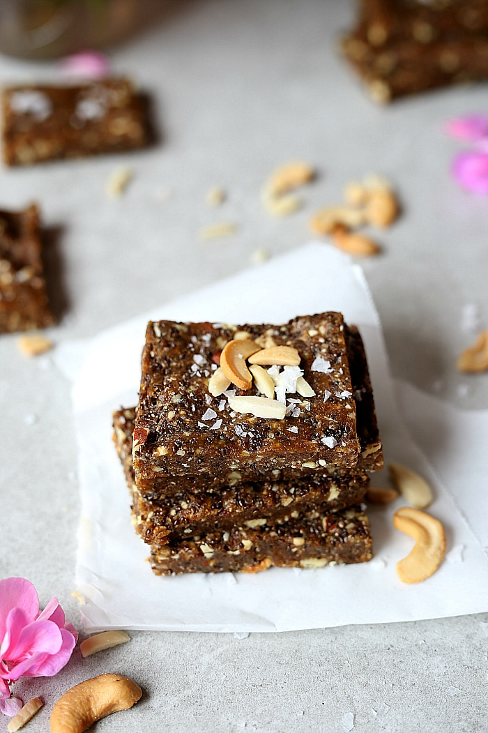 Heavenly date bars that aredevilishly good! A decadentraw bar rich in natural sweetness fromMedjool dates! These easy raw chia date bars take as little as 10 minutes to make! They are the deliciously soft and make the perfect superfood energy pick-me-up after a workout or first thing in the morning! #raw #date #bars #snacks #healthy #glutenfree #grainfree #paleo #easy #homemade | Recipe at delightfulmomfood.com