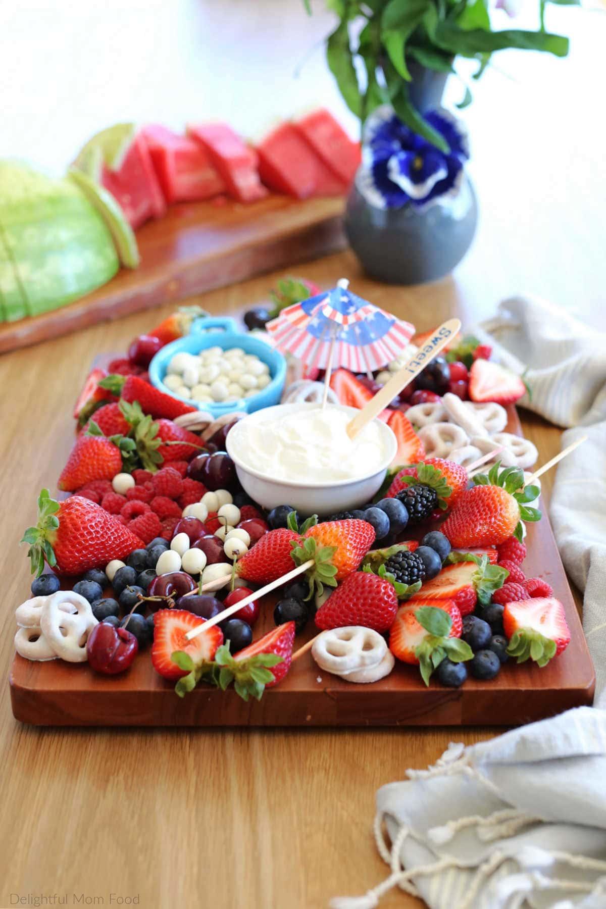simple red white blue fruit platter with blueberries strawberries cherries yogurt covered pretzels and yogurt dip