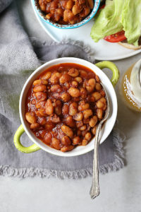 gluten free baked beans in a bowl with a spoon