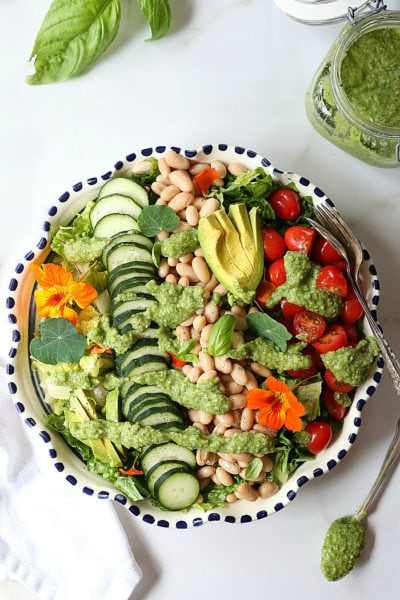 Simple salad made with white beans, plump tomatoes, cucumbers, and a creamy avocado broccoli pesto dressing. This vegan salad is easy to put together and the perfect plant-based meal to detox and build lean muscles. #plantbased #simple #healthy #salad #vegan #vegetarian #whitebean #tomato #cucumber #paleo #whole30 #lowcarb #keto | Recipe at delightfulmomfood.com