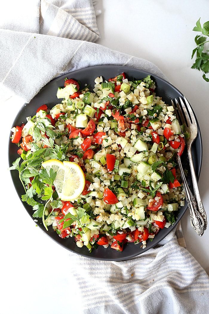 Cauliflower tabbouleh is an excellent substitute for a grain-free dish using cauliflower rice! Tabbouleh is a staple vegetarian salad of the Middle East served cold with fresh parsley, tomatoes and a light olive oil dressing. #cauliflower #tabbouleh #tabbouli #side #recipe #healthy #glutenfree #lowcarb #paleo #whole30 #vegan #vegetarian | Recipe at delightfulmomfood.com