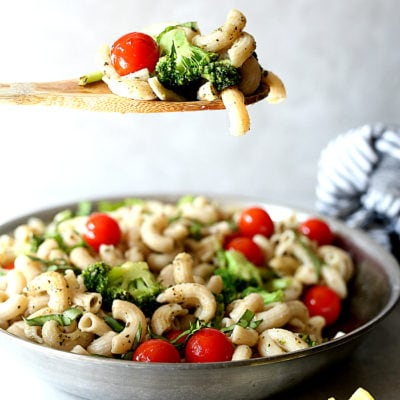 Broccoli pasta recipe quickly made in one pan tossed in Italian seasonings with juicy tomatoes! Sauteed broccoli florets, grape tomatoes and pasta noodles in an olive oil dressing is a quick and easy dinner ready in less than 30 minutes! This savory dish is gluten-free, vegan and vegetarian but feel free to add cooked chicken or sausage slices if you are craving meat! #vegetarian #vegan #onepan #onepot #pasta #broccoli #tomatoes #glutenfree #healthy #recipe | Recipe at delightfulmomfood.com