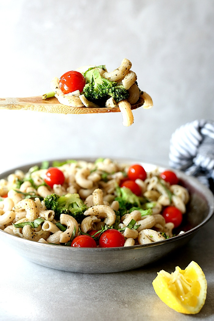 Broccoli pasta recipe quickly made in one pan tossed in Italian seasonings and juicy tomatoes! Sautee broccoli florets and grape tomatoes in olive oil then add to the pasta for a quick and easy dinner ready in less than 30 minutes! This savory dish is gluten-free, vegan and vegetarian but feel free to add cooked chicken or sausage slices if you are craving meat! #vegetarian #vegan #onpan #onepot #pasta #broccoli #tomatoes #glutenfree #healthy #recipe | Recipe at delightfulmomfood.com