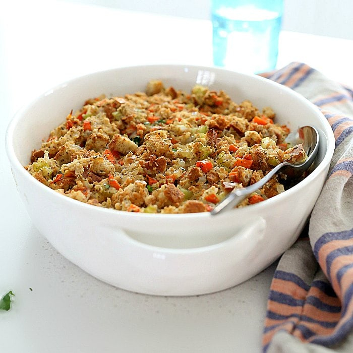 This gluten-free stuffing recipe is the BEST comfort food for the holidays! Gluten-free stuffing is simple to make with rich flavorful herbs, vegetables and gluten-free bread. It is plant-based and can be made vegan or stuffed in a turkey for meat lovers!  #glutenfree #stuffing #recipe #healthy #baked #Thanksgiving #Christmas #holiday #food | delightfulmomfood.com