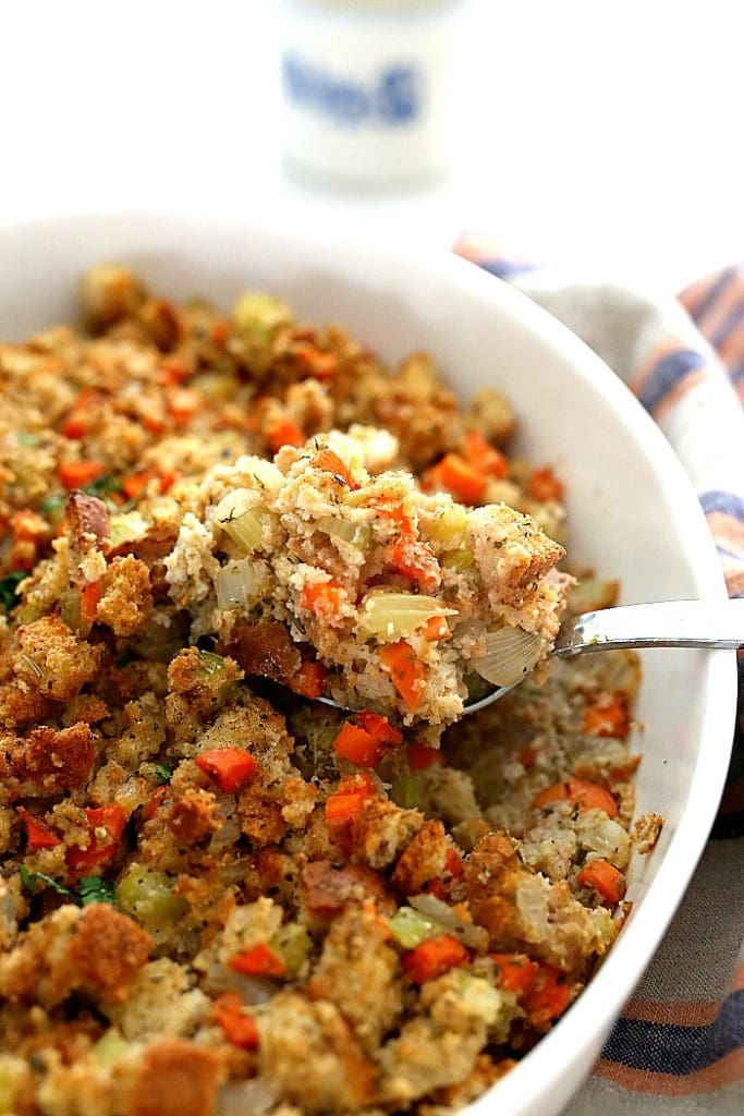 gluten-free stuffing made with carrots, celery, onion and gluten-free bread served on a spoon