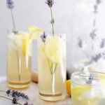 glasses filled with fresh homemade lavender lemonade, ice and lavender plant buds