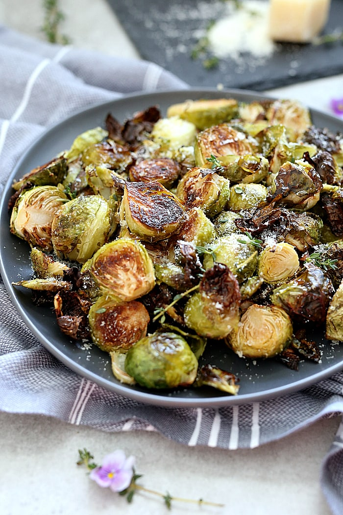 Oven roasted brussels sprouts tossed and baked in flavorful oil, salt and pepper. This easy side dish is gluten-free, vegetarian and for a bonus is delicious topped with freshly grated Parmesan cheese or nutritional yeast. #brusselssprouts #recipe #oven #roasted #quick #healthy #glutenfree #vegan #vegetarian #sidedish | recipe at delightfulmomfood.com