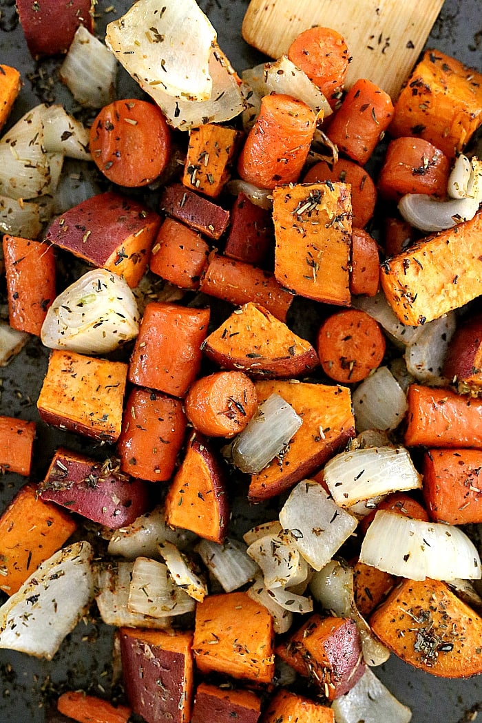 Savory roasted sweet potatoes, carrots and onion over cauliflower rice is a family favorite Buddha bowl ready in minutes! This Buddha bowl is deliciously packed with irresistible flavors and caters to most diets including gluten-free, Whole 30, Paleo and vegan! #glutenfree #buddhabowl #roasted #sweetpotatoes #carrots #sheetpan #easy #cauliflowerrice #whole30 #vegan #vegetarian | Recipe at delightfulmomfood.com