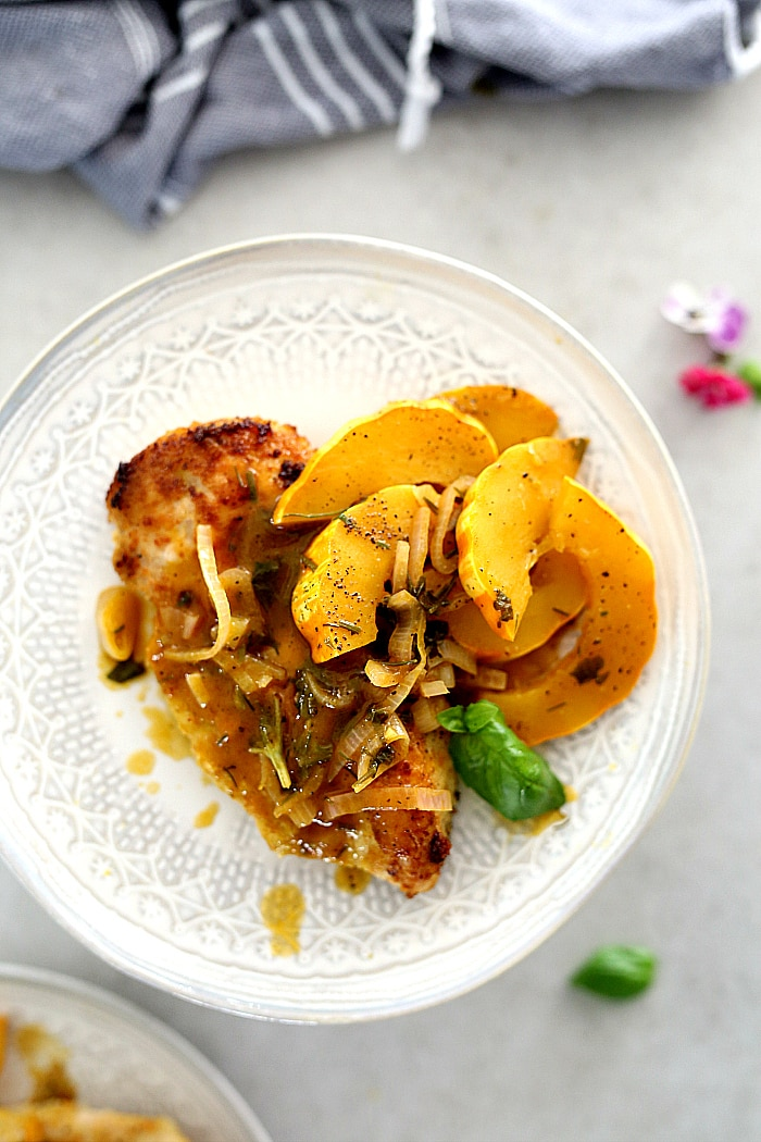 Easy chicken breast recipe with delicata squash & shallot sauce made in one-pan in 30 minutes! Learn how to make a crispy, juicy paleo chicken breast on the stove with these secrets. It is a Whole30, Keto, paleo approved dish the whole family will love! #easy #chicken #recipe #glutenfree #Whole30 #paleo #onepan #Keto #sauce #30minutemeals #healthy | Recipe at delightfulmomfood.com