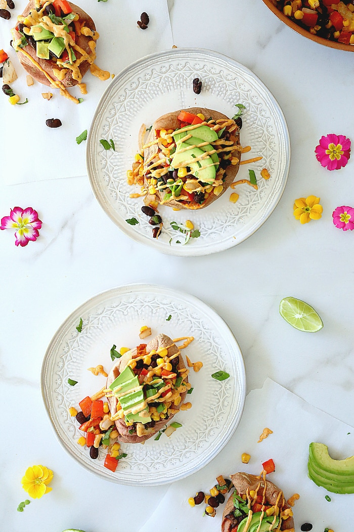 Vegan Mexican stuffed sweet potatoes with drizzled spicy southwest sauce! The starchy sweet vegetables are so good for you and stuffed sweet potatoes are easy to create! #Mexican #stuffed #sweetpotatoes #recipe #food #glutenfree #vegan #easy #quick #healthy #potatoes | Recipe at delightfulmomfood.com