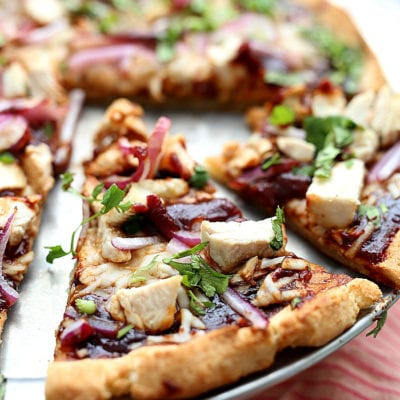 Barbecue Chicken Cauliflower Crust Pizza! How about a good pizza recipe without the bloated feeling after eating it?! 😊 This cauliflower crust BBQ chicken pizza is so flavorful, crispy, thin, light and your gut will thank you! It is packed with vegetables and protein and a copycat Trader Joe's cauliflower crust. delightfulmomfood.com #cauliflower #rice #pizza #glutenfree #crust #cauliflowerpizzacrust #healthy #dairyfree #barbecue #chicken #bbq #recipe