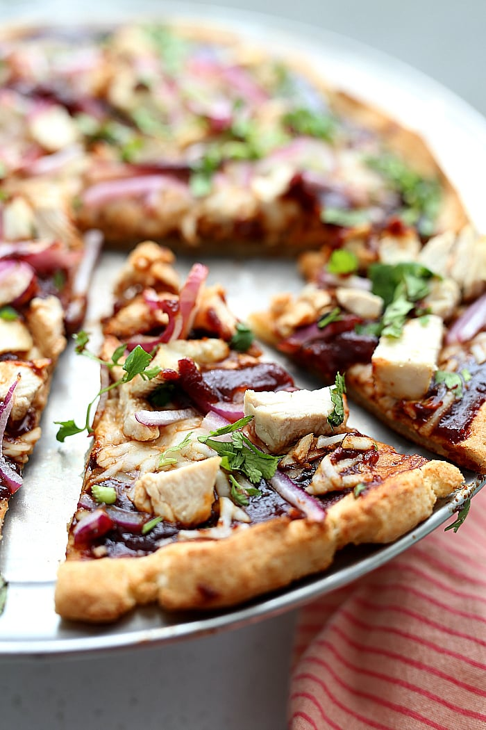 Barbecue Chicken Cauliflower Crust Pizza! How about a good pizza recipe without the bloated feeling after eating it?! 😊This cauliflower crust BBQ chicken pizza is so flavorful, crispy, thin, light and your gut will thank you! It is packed with vegetables and protein and a copycat Trader Joe's cauliflower crust. delightfulmomfood.com #cauliflower #rice #pizza #glutenfree #crust #cauliflowerpizzacrust #healthy #dairyfree #barbecue #chicken #bbq #recipe
