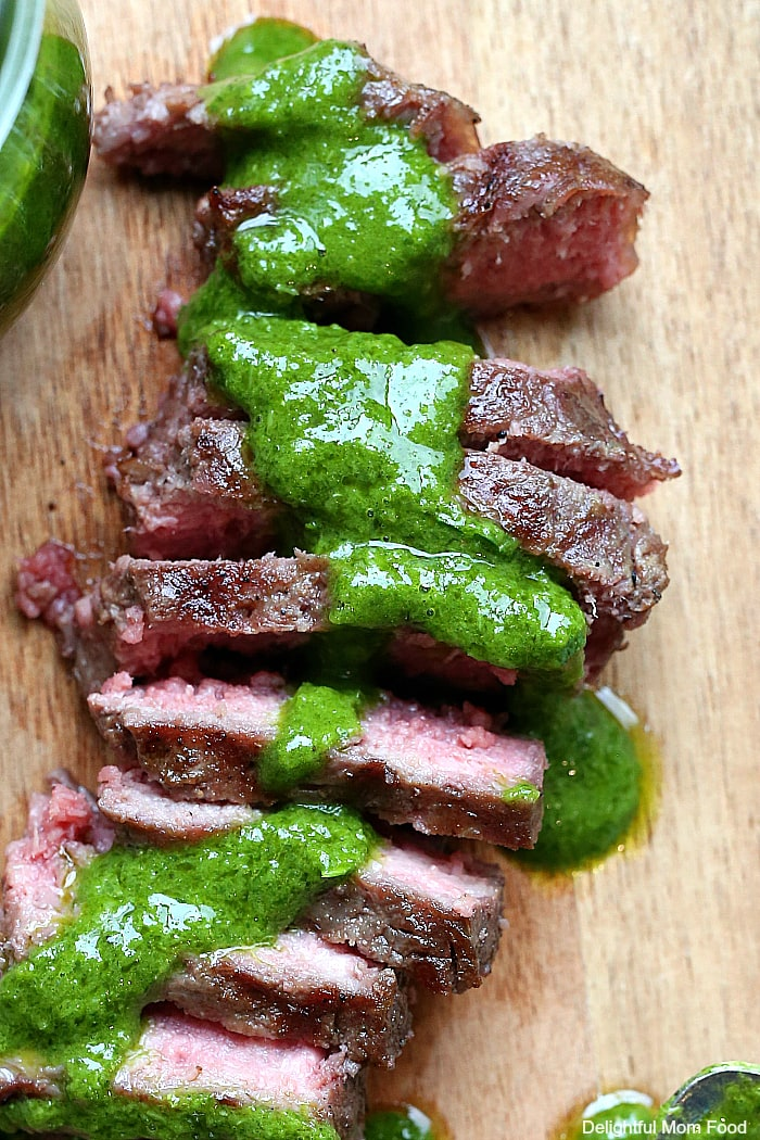 The popular chimichurri sauce recipe is a beloved steak sauce you will want to top over everything! Use this zesty chimichurri recipe as salad dressing, marinade, dip and sauce! #chimichurri #sauce #recipe #steaksauce #dip #marinade #dressing #herbs | Delightful Mom Food