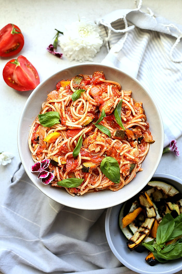 Use up fresh zucchini, yellow squash and juicy plum tomatoes in this mouthwatering healthy spaghetti recipe! This gluten-free summer pasta doesn't compare to other spaghetti! #healthy #summer #pasta #spaghetti #glutenfree #recipe #zucchini #squash #main #dinner | recipe at Delightful Mom Food