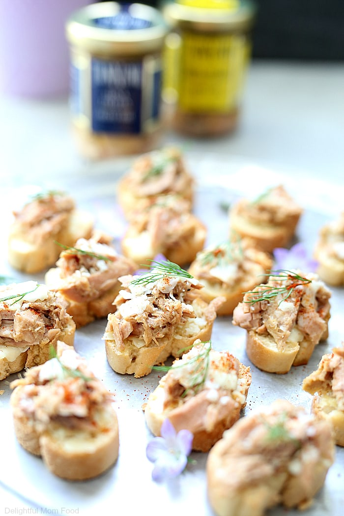 These gluten-free crostini tuna melt appetizers make the perfect finger food appetizer for any holiday party! Made with only 3 main ingredients so when you need a quick appetizer dish to win the crowd over – this one is it! #tunamelt #appetizers #glutenfree #healthy #recipe #crostini #holiday #partyfood #fingerfood | Recipe at Delightful Mom Food