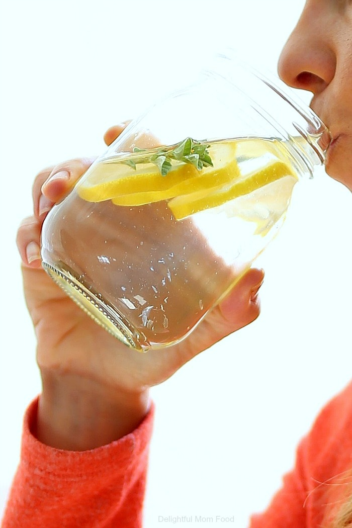 A flavorsome and simple method to enjoy cold and hot lemon water and 10 benefits why you should be drinking lemon water every day including for detox, hydration, gorgeous skin and efficient liver function! #lemonwater #detox #water #recipe #weightloss #lemon #infusedwater #benefits #healthyliving #health | Delightful Mom Food