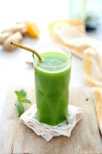 Fresh detox green juice made of cucumbers, celery, ginger, romaine lettuce, and lemon to promote body cleanse and assist in weight loss! Learn how to make it in a blender and drink this magical green drink every morning!  #detox #greenjuice #drink #greendrink #drink #beverage #juice #healthy #cleansing #weightloss #wellness | Recipe at Delightful Mom Food