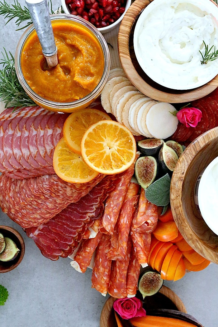 Celebrate and host a party with this Charcuterie board! This winning Charcuterie platter is loaded with meats, dried fruit, the perfect dips, gluten-free crackers and tips on how to make the perfect holiday Charcuterie board- the greatest focal point to every party!  #charcuterieboard #charcuterie #glutenfree #recipe #wholesome #appetizer | Recipe at Delightful Mom Food