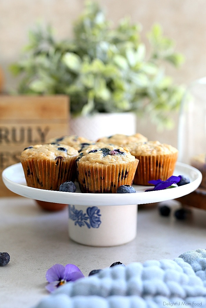 The fluffiest gluten free blueberry muffins recipe! These healthy and easy blueberry oat muffins are seriously the best gluten-free muffins! They are also dairy-free and packed with fiber, juicy blueberries, rolled oats and a hint of lemon zest. #glutenfree #muffins #recipe #healthy #oats #oatmeal #breakfast #brunch #snack #baking #dairyfree #blueberry #blueberries #delightfulmomfood | Recipe at Delightful