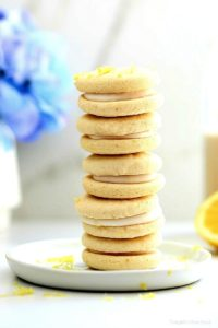 The perfect bright and cheery healthier cookies for spring! This soft lemon cookie recipe is vegan and gluten-free, turned into a sandwich filled with rich lemon icing that soaks into the cookies for a taste that tantalizes your taste buds! #softlemoncookierecipe #veganlemoncookies #lemoncookies #glutenfreelemoncookies #lemonfilledcookies #dessert #treats #easycookierecipe #healthycookierecipe | Recipe at Delightful Mom Food