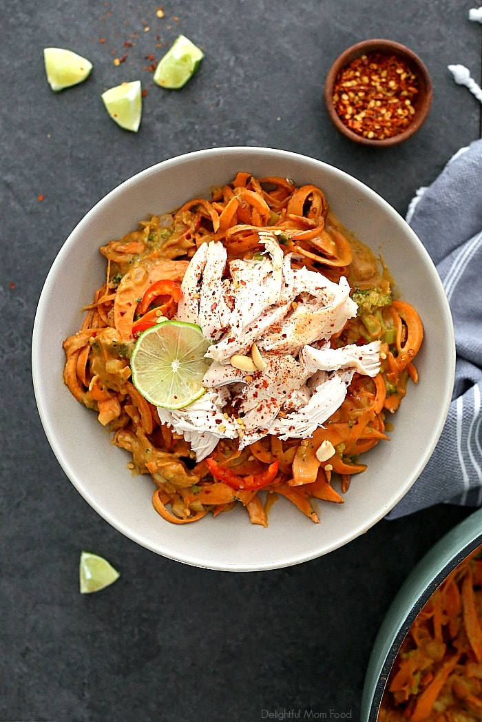 Spicy sweet potato pasta in a creamy red chili and broccoli peanut sauce and tossed with rotisserie chicken that comes together quickly at moments notice. Peanut, ginger, soy, and garlic are what make this spicy sweet potato pasta recipe spectacular! It's bursting with delicious Asian flavors you'd expect from a Chinese restaurant without the excess fat or expense. #sweetpotatopasta #sweetpotatorecipe #sweetpotato #noodles #zoodles #recipe #dinner #glutenfreepasta | Recipe at Delightful Mom Food