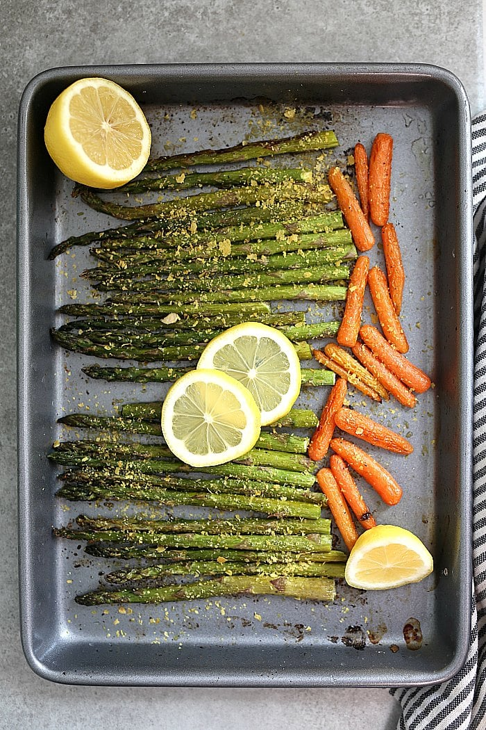Use seasonal spring asparagus for this easy roasted asparagus and carrots recipe! It makes an excellent side dish in as little as 20 minutes - hands-free! #roastedvegetables #roastedasparagusandcarrots #asparagus #carrots #recipe #glutenfree #healthy #sidedish #easysidedish #vegan | Recipe at Delightful Mom Food