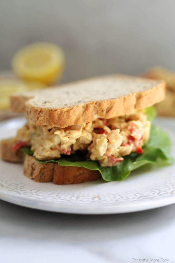 chickpea tuna salad sandwich with lettuce on a plate