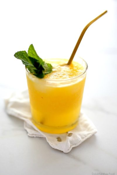 Mango cocktail recipe sweetened naturally with mango puree and fresh citrus juice mixed with vodka and sparkling water. Enjoy this refreshing drink when you're looking for an alcoholic beverage on the skinny side!#mango #mangococktail #mangopureerecipe #mangodrink #beverage #alcoholicbeverage #recipe #skinny #naturalsugar #lite | Recipe at Delightful Mom Food
